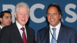 Scioli junto a Bill Clinton en el encuentro anual de su fundación