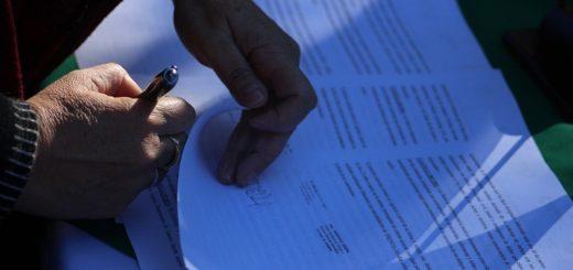 Acuerdo para resolver los títulos de dominio de propiedad de escuelas