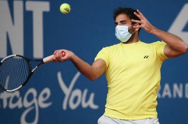 Coronavirus: el alemán Benjamin Hassan, primer tenista en jugar con barbijo un partido